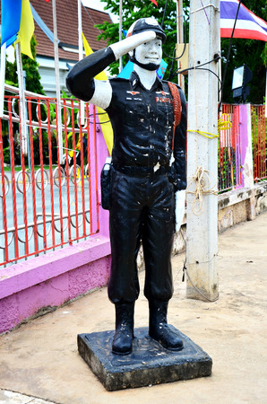 road warrior: Policeman figures stand at road