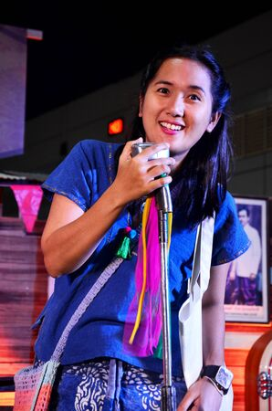ballad: Thai woman singing folk song on stage at the largest expo for market and entertainment retro at IMPACT Muang Thong Thani on October 16, 2015 in Nonthaburi, Thailand