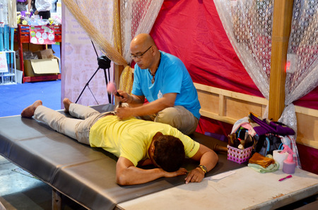 thai people: Thai people thai Massage Tok-Sen or Massage hammer punch line  at IMPACT Muang Thong Thani on October 16, 2015 in Nonthaburi, Thailand.