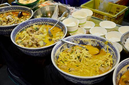 fried foods: Delicious thai spicy curry and fried foods serve with rice at restaurant in market , Thailand