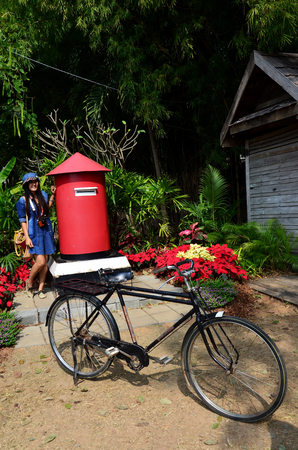 jim: Thai woman portrait with postbox at Jim Thompson Farm on December 30, 2013 in Nakhon Ratchasima, Thailand