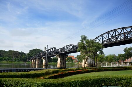 internationally: People travel and walking at the Bridge of the River Kwai. Internationally famous, black iron bridge was built from by Japanese supervision by Allied prisoner-of-war labour as part of the Death Railway linking Thailand with Burma in Kanchanaburi, Thailand Stock Photo