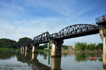 internationally: People travel and walking at the Bridge of the River Kwai. Internationally famous, black iron bridge was built from by Japanese supervision by Allied prisoner-of-war labour as part of the Death Railway linking Thailand with Burma in Kanchanaburi, Thailand Editorial