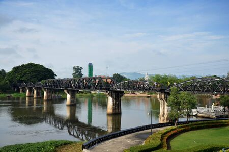 allied: People travel and walking at the Bridge of the River Kwai. Internationally famous, black iron bridge was built from by Japanese supervision by Allied prisoner-of-war labour as part of the Death Railway linking Thailand with Burma in Kanchanaburi, Thailand Stock Photo