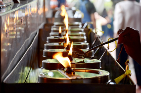 chaimongkol: Tradition and culture of thailand, Thai people offering oil lamps to fill in the lamp of birthday at Wat Yai chaimongkol in Ayutthaya, Thailand Stock Photo
