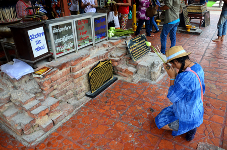 chaimongkol: Thai people pray with flower, joss stick and candle for Buddha statue at Wat Yai chaimongkol on October 9, 2015 in Ayutthaya, Thailand Editorial