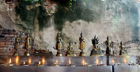 chaimongkol: Tradition and culture of thailand, Thai people offering oil lamps to fill in the lamp of birthday at Wat Yai chaimongkol on October 9, 2015 in Ayutthaya, Thailand.  Buddha statue for people offering oil lamps to fill in the lamp of birthday is one merit w
