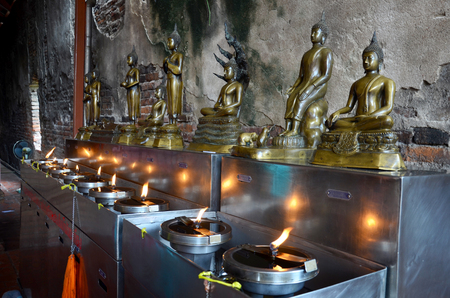 make belief: Buddha statue for people offering oil lamps to fill in the lamp of birthday is one merit with belief that it will make it a sacred destiny to life founded to make life an auspicious destiny brilliance
