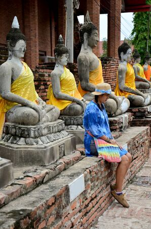 thailand art: Thai woman portrait with buddha statue of Wat Yai chaimongkol in Ayutthaya, Thailand Stock Photo