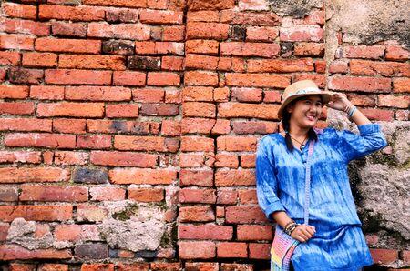 chaimongkol: Thai woman portrait at Brick wall Background of Wat Yai chaimongkol in Ayutthaya, Thailand
