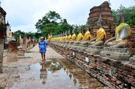 chaimongkol: Thai woman wear mauhom clothes portrait with buddha statue of Wat Yai chaimongkol in Ayutthaya, Thailand