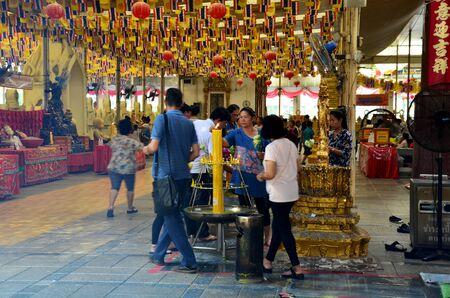 buddhism prayer belief: People praying Luang Pho Wat Rai Khing is a statue of Buddha at Mongkhon Chindaram Temple on November 4, 2015 in Nakhon Pathom, Thailand.