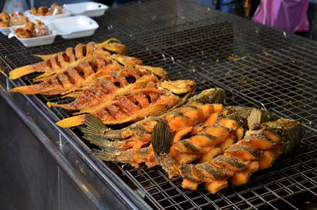 striped snake head fish: Snake-head fish deep Fried and Tilapia Fish deep Fried for sale at Don Wai Floating Market in Nakhon Pathom, Thailand.
