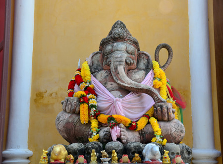 lord ganesha: Ancient Ganesha or Ganesh figure : Lord of Success (The Hindu Elephant-Deity) at Prasat Nakhon Luang, Ruin of Ayutthaya in Thailand Stock Photo