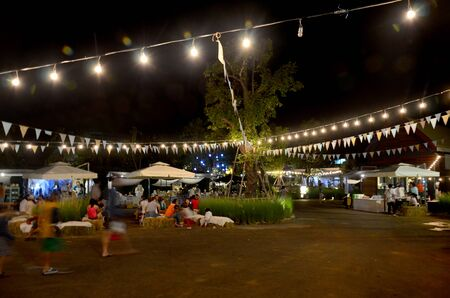 local festivals: Thai people travel and shopping at market fair in night time on November 29, 205 in Nakhon Ratchasima, Thailand.
