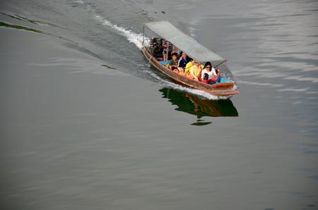 vestige: People driving long tail boat bring traveller go to Wat Sam Prasob (The Sunken Temple) underwater Samprasob River on December 4, 2015 in Kanchanaburi, Thailand. Editorial