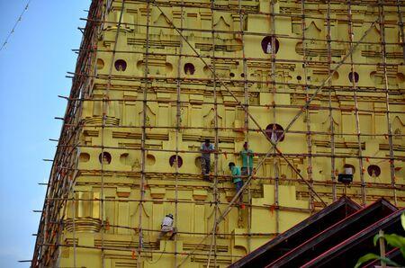 wiwekaram: Thai people renovate Chedi Buddhakhaya location at near Wat Wang Wiwekaram or Wat Mon, is a symbol of Sangkhlaburi on December 3, 2015 in Kanchanaburi, Thailand Editorial