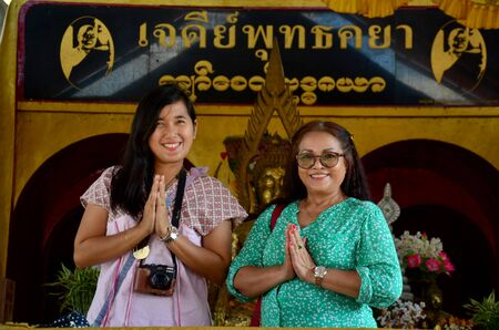 wiwekaram: Thai people praying buddha statue at Chedi Buddhakhaya near Wat Wang Wiwekaram or Wat Mon at Sangkhlaburi on December 3, 2015 in Kanchanaburi, Thailand