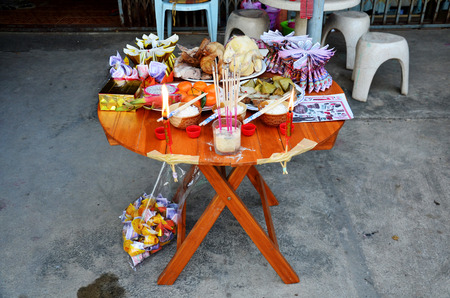ancestor: People putting Sacrificial offering food for pray to god and memorial to ancestor in Chinese new year day at home on February 7, 2016 in Nonthaburi, Thailand.