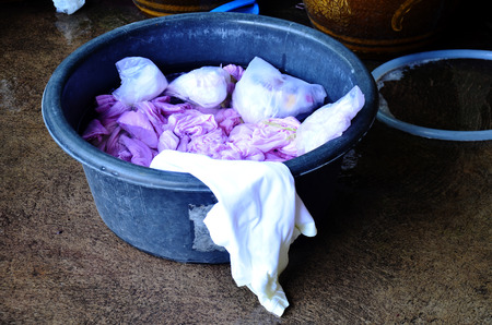dyeing: Thai women washing and clean clothes after tie batik dyeing natural color at Nonthaburi, Thailand.