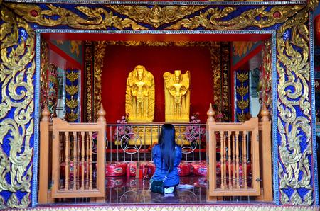 praying angel: Thai woman praying Angel Statue of Suphanburi city pillar shrine on January 5, 2016 in Suphanburi, Thailand.
