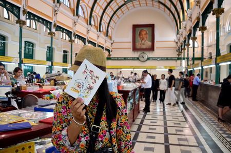center hall colonial: Thai woman travel and portrait at Ho Chi Minh Central Post office on January 22, 2016 in Ho Chi Minh, Vietnam