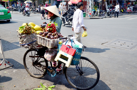 greengrocery: Vietnamese people with Bicycle Fruit Shop or greengrocery on street near Ben Thanh Market on January 22, 2016 in Ho Chi Minh, Vietnam