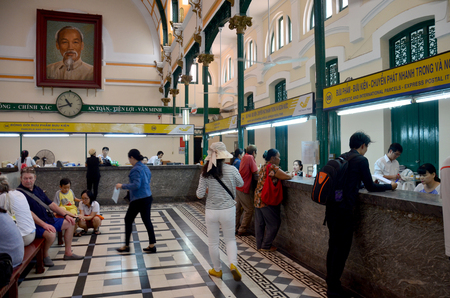 center hall colonial: People travel and shopping at Ho Chi Minh Central Post office on January 22, 2016 in Ho Chi Minh, Vietnam