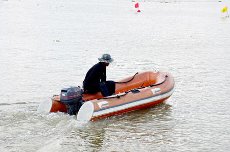 inflatable boat: Security guard riding Inflatable Boat in Long boat Racing at Chaopraya river in Nonthaburi, Thailand