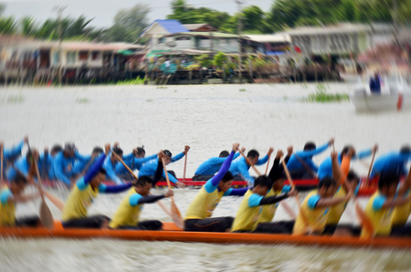 racing festival: Blurred of motion of thai people rowing long boat in long boat racing festival at Nonthaburi, Thailand