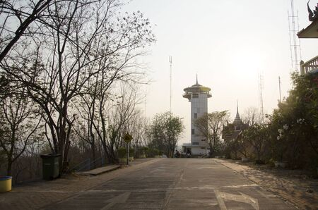 nakhon: Nakhon Sawan Tower sits on top of Khiriwong Temple Hill to serve tourists visiting and sightseeing cityscape on March 15, 2016 in Nakhon Sawan, Thailand.