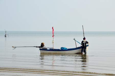 40 year old: 40 year old Fisherman prepare boat for fishing in Andaman Sea at Surat Thani, Thailand