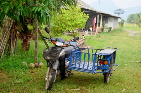 sidecar: Old local Motorcycle Sidecar for agriculture in Phatthalung, Thailand. Stock Photo
