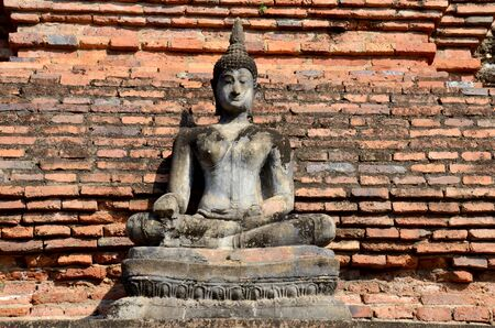 associated: Buddha statue damage and broken with Ancient building at Historic Town of Sukhothai and Associated Historic Towns in Sukhothai, Thailand