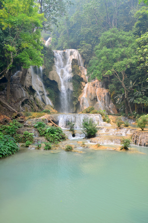 si: Motion of water at Kuang Si Falls or Tat Kuang Si Waterfalls in Luang Prabang, Laos