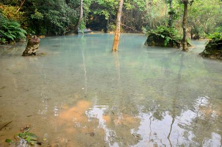 tat: Motion of water at Kuang Si Falls or Tat Kuang Si Waterfalls in Luang Prabang, Laos