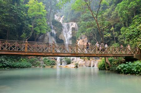 tat: People on bridge looking and take photo with viewpoint of Kuang Si Falls or Tat Kuang Si Waterfalls on April 8, 2016 in Luang Prabang, Laos