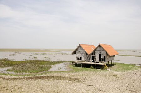 waterfowl: Damaged old house at Thalesap Songkhla and Thale Noi Waterfowl Reserve Park in Phatthalung, Thailand. Stock Photo