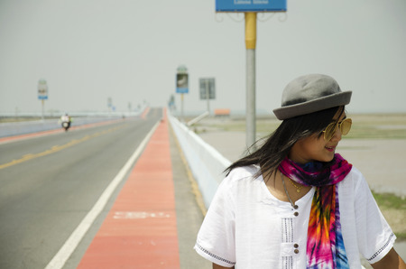 thanon: Thai woman travel and portrait on Thanon Chaloem Phra Kiat 80 Phansa Road in Phatthalung, Thailand.