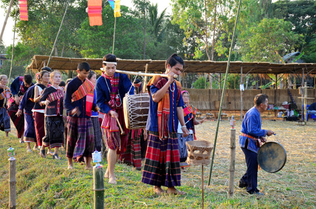 none: Phu Thai people singing and playing traditional thai musical instruments phu thai style for show at Ban None Hom on January 15, 2016 in Sakon Nakhon, Thailand Editorial