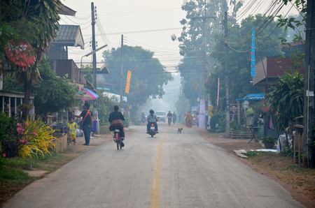 almsgiving: Lifestyle of phutai people style in countryside at Ban Non Hom in morning time in Sakon Nakhon, Thailand