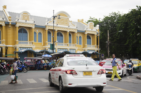 Traffic road and people walking cross over road at crosswalk at Tha Phra Chan famous as market for Thai amulets near Wat Phra Kaew on June 28, 2016 in Bangkok, Thailand