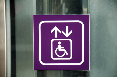 nonthaburi province: Symbol label lift or escalator for person disabled for moving up and down MRT Purple Line skytrain in Nonthaburi Province, Thailand Stock Photo