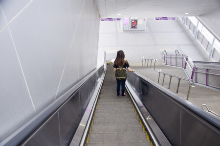 nonthaburi province: Thai women use escalator for move down at MRT Purple Line skytrain at Bang Yai station in Nonthaburi Province, Thailand