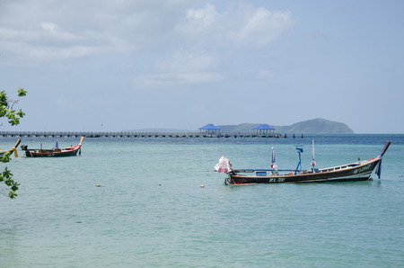 fishery: Wooden fishery boat floating and stop wait for fishing in evening time at Rawai beach at sea and ocean andaman on June 9, 2016 at Phuket, Thailand