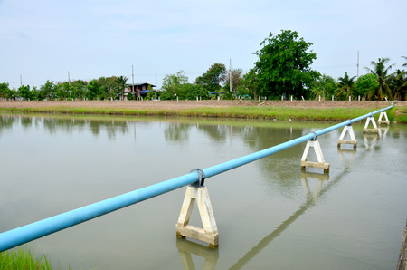 Canal watercourse waterway of water supply with water pipe in countryside Nonthaburi, Thailand