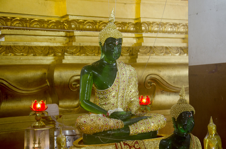 jade buddha temple: Model of Emerald Buddha image statue full official name Phra Kaeo Morakot or Phra Phuttha Maha Mani Rattana Patimakon in temple of Thailand