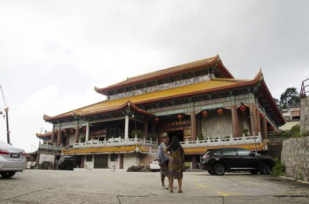 malaysian people: Traveller thai woman asking malaysian people at front of Kek Lok Si Chinese and Buddhist temple in Georgetown on April 26, 2016 in Penang, Malaysia.