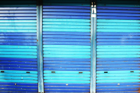 Colorful steel door roll shutter at home in George Town and street art area in Penang, Malaysia