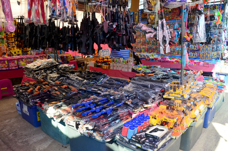 Plastic gun and other toy sale for kid at local market in Sakon Nakhon, Thailand